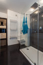 Minimalist apartment bathroom in black and white with turquoise towels Royalty Free Stock Images