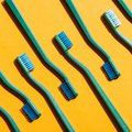 Background with green toothbrushes, on yellow Royalty Free Stock Photo