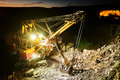 Mining construction industry. Excavator digging granite or ore in quarry Royalty Free Stock Photo