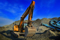 Mining digger with heavy shovel in action at mine Stock Photo