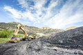 Mining machines coal and infrastructure in mountainous mine Royalty Free Stock Photos