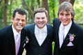 Minister posing with gay wedding couple a handsome he has just married focus is on the Stock Photography