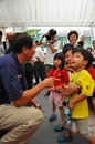 MINISTER TEO INTERACTING WITH KIDS Stock Photography
