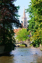 Minnewater Park and the Church of Our Lady in Bruges, Belgium Royalty Free Stock Photo
