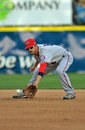 Minor league baseball - fielding a grounder Stock Image