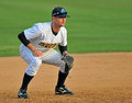 Minor league baseball - third baseman waits Stock Image