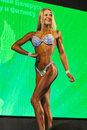 Minsk belarus april professional caucasian female bodybuil bodybuilder performing on stage during bodybuilding and fitness Royalty Free Stock Photo