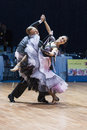 Minsk belarus february dance couple of parfyonov deni denis and sopit tetiana from ukraine performs adult standard european Stock Image