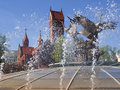 Minsk main square fountain splashes by sunny day at the nezalezhnascy in city with famous red church behind Stock Image