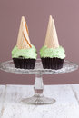 Mint choc chip cupcakes with ice cream cones Royalty Free Stock Image