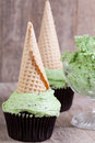 Mint choc chip cupcakes with ice cream cones Stock Images