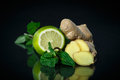 Mint ginger and lemon on black background Royalty Free Stock Image