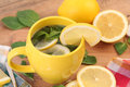 Mint and lemon hot tea with Royalty Free Stock Photos