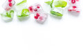 Mint and red berries in ice cubes white background top view mockup Royalty Free Stock Photo