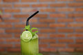 Mint smoothie with lime in glass Stock Photography