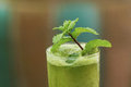 Mint smoothie with lime in glass Royalty Free Stock Image