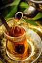 Mint tea pouring into turkish glass Stock Photography