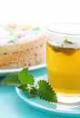 Mint tea and sponge cake with flowers Royalty Free Stock Images