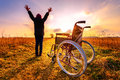 Miracle recovery young girl gets up from wheelchair and raises hands overjoyed standing a Stock Photography