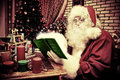 Miracle time santa claus making christmas gifts at home Royalty Free Stock Photography