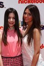 Miranda cosgrove victoria justice at the iparty with victorious premiere event the lot hollywood ca Stock Images