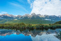 Mirror lakes are a famous natural landmark omn the milford road in the fiordland national park snowy mountains are reflecting in a Stock Photography