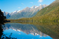 Mirror lakes are a famous natural landmark omn the milford road in the fiordland national park snowy mountains are reflecting in a Royalty Free Stock Photo