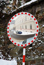 Mirror on road before turn Royalty Free Stock Photography