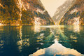 Mirror surface of lake Koenigsee reflecting the rocky mountains Royalty Free Stock Photo
