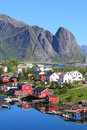 Mirroring cabins of reine in lofoten the village for the times magazine the most beautiful place the world Royalty Free Stock Image