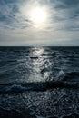 Mirroring on ocean surface sundown light dark blue breakers Stock Photo