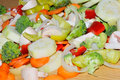 Miscellaneous fresh vegetables cut up in pieces ready for stir f fry or saute it includes carrots broccoli onions asparagus squash Royalty Free Stock Photo