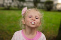 Mischief child blowing chewing gum bubbles Royalty Free Stock Photo