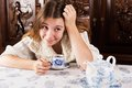 Mischievous attractive young woman looking off to the side with cofee cup a contemplative playful expression Royalty Free Stock Photo