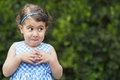 Mischievous girl expression exterior photo year old with Royalty Free Stock Photo