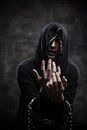 Miserable cultist portrait of chained young man in hood Stock Images