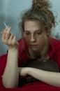 Miserable woman smoking cigarette Royalty Free Stock Photo