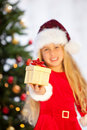 Miss santa holding  gifts Stock Images
