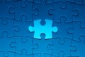 Missing jigsaw puzzle piece with light glow Royalty Free Stock Photo