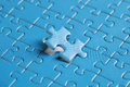 The missing piece of puzzle success teamwork and finishing or ending Royalty Free Stock Photo