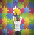 Missing piece young boy holds the of the puzzle Royalty Free Stock Images