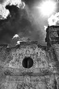 Mission san jose against a texas sky with harsh sun black and white photograph of facade background of clouds and photographed Stock Photos