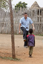 Missionary playing with child in africa Royalty Free Stock Image