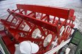 Mississippi river paddle boat wheel view from over the stern on a riverboat on the red with white supports and green deck Royalty Free Stock Image