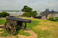 Mississippi river scenic view from a knoll above visitors and information center in vicksburg with civil war cannon in foreground Royalty Free Stock Photo