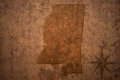 Mississippi state map on a old vintage paper background Royalty Free Stock Photo