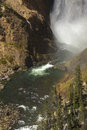MIst at the bottom of Lower Falls, Yellowstone River, Wyoming. Royalty Free Stock Photo