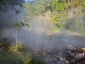 Mist from the geyser hot spring in huai nam dang national park chiang mai thailand Royalty Free Stock Image