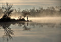 Mist on the lake at sunrise Royalty Free Stock Photo