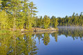 Mist and reflections in the early morning on ottertrack lake boundary waters Royalty Free Stock Photo